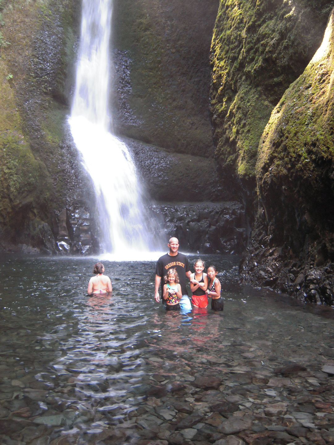 Little ones and Dad braving the cold Falls water.